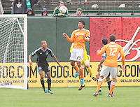 San Francisco, California - Saturday March 17, 2012: Brian Ching jumps for the ball during the MLS match at AT&T Park. Houston Dynamo defeated San Jose Earthquakes  1-0
