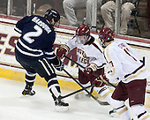 Connor Hardowa (UNH - 2), Teddy Doherty (BC - 4), Destry Straight (BC - 17) - The Boston College Eagles and University of New Hampshire Wildcats tied 4-4 on Sunday, February 17, 2013, at Kelley Rink in Conte Forum in Chestnut Hill, Massachusetts.
