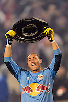 New York Red Bulls goalkeeper Luis Robles (31) celebrates with the Supporters Shield. The New York Red Bulls defeated the Chicago Fire 5-2 during a Major League Soccer (MLS) match at Red Bull Arena in Harrison, NJ, on October 27, 2013.