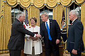 US President Donald J. Trump (2-R) shakes hands with Rex Tillerson (L) after Tillerson was sworn-in as Secretary of State by US Vice President Mike Pence (R), as Tillerson's wife Renda St. Clair (2-L) looks on; in the Oval Office of the White House in Washington, DC, USA, 01 February 2017. Tillerson was confirmed by the Senate, 01 February, in a 56-to-43 vote to become the nation's 69th Secretary of State.<br /> Credit: Michael Reynolds / Pool via CNP