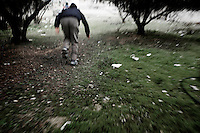 SYRIA - Al Qsair. Running away from Syrian Army snipers in Al Qsair, on January 25, 2012. Al Qsair is a small town of 40000 inhabitants, located 25Km south-west of Homs. The town is besieged since the beginning of November and so far it counts 65 dead. ALESSIO ROMENZI