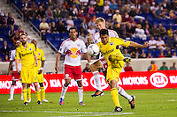 Jairo Arrieta (25) of the Columbus Crew shoots as Markus Holgersson (5) of the New York Red Bulls defends. The New York Red Bulls defeated the Columbus Crew 3-1 during a Major League Soccer (MLS) match at Red Bull Arena in Harrison, NJ, on September 15, 2012.