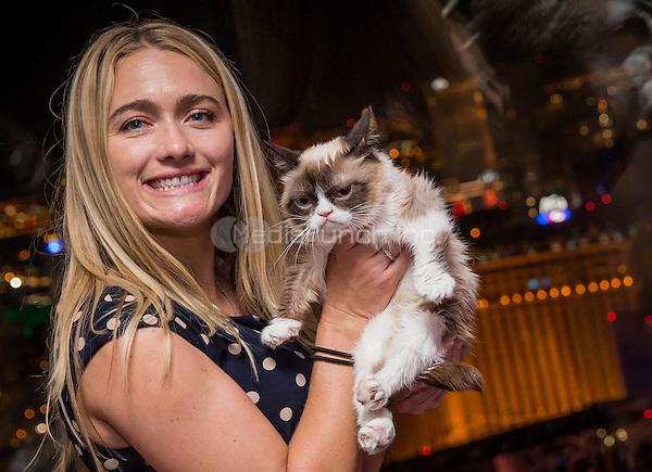LAS VEGAS, NV - August 5: Grumpy  Cat Owner Tabatha Bundesen and Grumpy Cat pictured as Grumpy Cat rides The High Roller Observation Wheel after her book signing at Kitson at The Linq in Las Vegas, NV on August 5, 2014. Credit: RTNEKabik/MediaPunch***HOUSE COVERAGE***