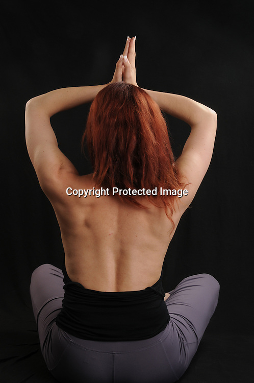 Stock photo of woman doing yoga