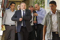 Former Israeli Foreign Minister Avigdor Lieberman (2L) makes his way at Jerusalem Magistrate's Court on July 02, 2013, as he is facing charges of fraud and breach of trust in the appointment of Zeev Ben Arie as Israel's ambassador to Latvia.
