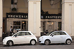 Cafe and two Fiat 500 Cars on Via Po Street in Turin - Torino, Italy