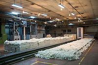 Raw cotton being processed using a machine in the Blow Room of the Pratibha vertically integrated garment unit in Indore, Madhya Pradesh, India on 11 November 2014. Photo by Suzanne Lee for Fairtrade
