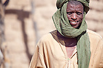 Fulani man in the seasonal village of Bantagiri in northern Burkina Faso.  The Fulani are traditionally nomadic pastoralists, crisscrossing the Sahel season after season in search of fresh water and green pastures for their cattle and other livestock.  The turban protects against dust kicked up by the livestock as well as the harsh Harmattan winds.