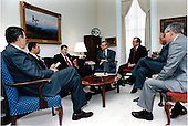 United States President Ronald Reagan meets with senior members of the National Security Council (NSC) staff on Tuesday, March 3, 1987 in the National Security Advisor's Office in the White House in Washington, D.C. Seated, from left: Vice President George H.W. Bush; Lieutenant General Colin Powell, Deputy National Security Advisor; President Reagan; Frank Carlucci, National Security Advisor; White House Chief of Staff Howard Baker; Grant Green, Executive Secretary, National Security Council; Ambassador Henry Cohen, member of the NSC staff.  The meeting included discussion on southern Africa, particularly Angola and Mozambique..Mandatory Credit: Bill Fitz-Patrick - White House via CNP