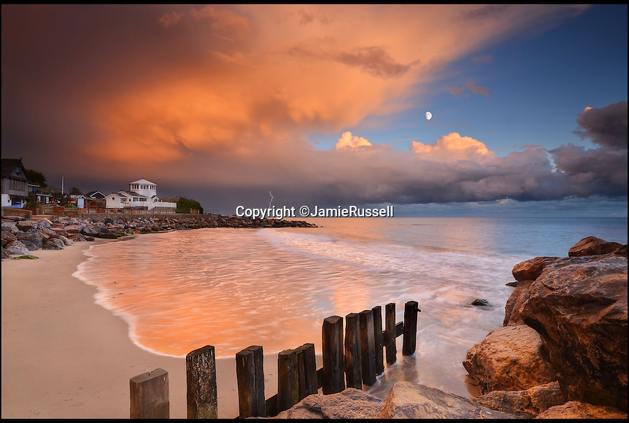 BNPS.co.uk (01202 55883&pound;)<br /> Pic: JamieRussell/BNPS<br /> <br /> ***Please Use Full Byline***<br /> <br /> Steephill Cove, evening storm<br /> <br /> Stunning photographs have revealed a turbulent side to the normally genteel Isle of Wight.<br /> <br /> The seemingly benign south coast holiday destination has been catalogued over a stormy year by local photographer Jamie Russell, and his astonishing pictures reveal the dramatic changes in weather that roll across the UK in just 12 months.<br /> <br /> Lightning storms, ice, floods, gales and blizzards have all been captured by the intrepid photographer who frequently got up in the middle of the night to capture the climatic chaos.<br /> <br /> Looking at these pictures prospective holidaymakers could be forgiven for thinking twice about a gentle staycation on the south coast island.
