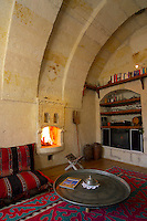 Goreme, Cappadocia, Turkey, July 2005. The livingroom is situated in an arched room built in 1958 and features an ottoman fireplace.  Dutch Photographer Frits Meyst and his wife Jillian Macdonald restored an old rock house in the village of Goreme. Since Roman Times people have been cutting graves and home out of the Soft tufo 'Fairy Chmney' rocks of Cappadocia. Photo by Frits Meyst / MeystPhoto.com