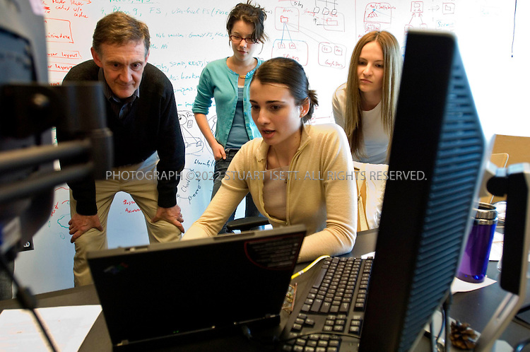 4/6/2007--Seattle WA, USA ..Ed Lazowska, a professor of computer science at the University of Washington's Paul G. Allen Center for Computer Science & Engineering, working with grad and undergrad students in a computer lab at the center...Students are left to right: Sierra Michels-Slettret, 21, Roxana Geambasu, 25, Tanya Bragin, 27, ..Photograph ©2007 Stuart Isett.All rights reserved