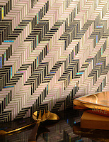 Houndstooth, a handmade mosaic backsplash shown in Amethyst and Rose Quartz jewel glass, is part of the Houndstooth Collection by Sara Baldwin for New Ravenna.<br />