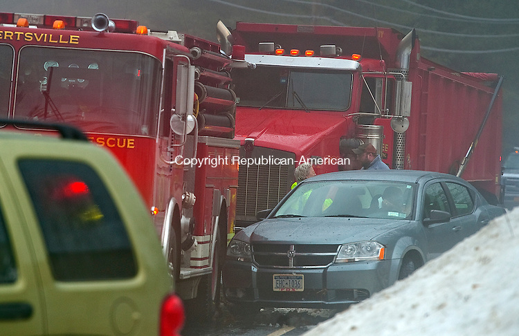 COLEBROOK, CT-010614JS02- While at the scene of a one vehicle accident on Colebrook River Road in Colebrook on Monday morning, a passing motorist lost control of their car and hit the back of a fire truck from Robertsville-Forge Fire Department. There was not damage to the truck.  Dense fog and black ice was heavy throughout the region with freezing temperatures coming again tonight. <br />  Jim Shannon Republican-American