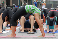Kia Miller, Joan Hyman, Tommy Rosen  and David Kim lead hundreds of people through poses during Yoga On The Promenade on Sunday, June 6, 2010. The free public yoga class was presented by Lululemon and Wanderlust.
