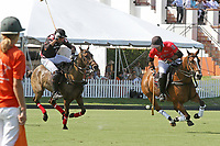 WELLINGTON, FL - MARCH 12:  Rodrigo Andrade of Audi (red jersey) controls the ball as Juan Chavanne of Orchard Hill rides with him, as Orchard Hill defeats Audi 9-8, in the early rounds of the 26 goal USPA Gold Cup at the International Polo Club, Palm Beach on March 12, 2017 in Wellington, Florida. (Photo by Liz Lamont/Eclipse Sportswire/Getty Images)