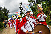 """Natives from the Kamentsá tribe, wearing colorful costumes, play drums and wind instruments during the Carnival of Forgiveness, a traditional indigenous celebration in Sibundoy, Colombia, 12 February 2013. Clestrinye (""""Carnaval del Perdón"""") is a ritual ceremony kept for centuries in the Valley of Sibundoy in Putumayo (the Amazonian department of Colombia), a home to two closely allied indigenous groups, the Inga and Kamentsá. Although the festival has indigenous origins, the Catholic religion elements have been introduced and merged with the shamanistic tradition. Celebrating annually the collaboration, peace and unity between tribes, they believe that anyone who offended anyone may ask for forgiveness this day and all of them should grant pardons."""
