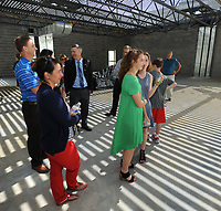 NWA Democrat-Gazette/ANDY SHUPE<br /> Dennis Chapman (center), president and head of school at The New School, answers questions Wednesday, April 19, 2017, while leading a tour of the school's gymnasium during a beam raising and tour of the school's expansion project in Fayetteville. The New School hopes to open the facility in the fall for the 2017-18 school year.