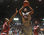 "Ole Miss forward Steadman Short (15)  is fouled by Arkansas' Rickey Scott (3) at C.M. ""Tad"" Smith in Oxford, Miss. on Saturday, March 5, 2010. Ole Miss won 84-74."