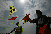 LUTZ TRECZOCKS WITH HIS YELLOW &quot;STOP PLUTONIUM&quot; KITE, JAPAN. 030702. .PIC &copy; JEREMY SUTTON-HIBBERT/GREENPEACE 2002..*****ALL RIGHTS RESERVED. RIGHTS FOR ONWARD TRANSMISSION OF ANY IMAGE OR FILE IS NOT GRANTED OR IMPLIED. CHANGING COPYRIGHT INFORMATION IS ILLEGAL AS SPECIFIED IN THE COPYRIGHT, DESIGN AND PATENTS ACT 1988. THE ARTIST HAS ASSERTED HIS MORAL RIGHTS. *******