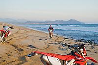 Motorcycle rider on beach, Baja, Mexico