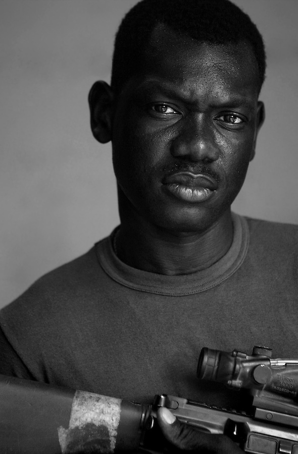 Sgt. Ricardo Marston, 26, Queens, New York. 1st Platoon, Kilo Company, 3rd Battalion, 1st Marine Regiment, 1st Marine Division, United States Marine Corps, at the company's firm base in Hit, Iraq on Friday Sept. 23, 2005.