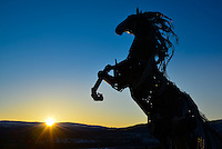 Whitehorse metal horse sculpture and sunrise