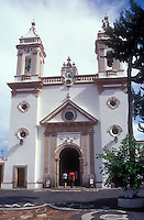 People entering the Templo de Santa Veracruz church in Taxco, Guerrero, Mexico