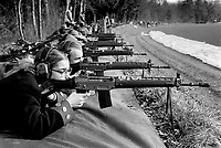 """Switzerland. Canton Bern. Neuenegg. Historisches Neueneggschiessen. A group of men and a woman are firing with automatic or semi-automatic assault rifles SG 550 during the traditional firing tournament for the Neuenegg battle's celebration. On March 5, 1798, under the command of Colonel Johann Rudolf von Graffenried, the Bernese army triumphed over numerically superior French troops under Brigadier General Pigeon. The Swiss proved their military skills by defeating a Napoleonic brigade. Napoleon still conquered Switzerland, but that hasn't prevented the celebration of Neuenegg's victory each year. Switzerland. Canton Bern. Neuenegg. Historisches Neueneggschiessen. A group of men and a woman are firing with automatic or semi-automatic assault rifles SG 550 during the traditional firing tournament for the Neuenegg battle's celebration. On March 5, 1798, under the command of Colonel Johann Rudolf von Graffenried, the Bernese army triumphed over numerically superior French troops under Brigadier General Pigeon. The Swiss proved their military skills by defeating a Napoleonic brigade. Napoleon still conquered Switzerland, but that hasn't prevented the celebration of Neuenegg's victory each year. The SG 550 is an assault rifle manufactured by Swiss Arms AG (formerly a division of Schweizerische Industrie Gesellschaft now known as Sig Holding AG) of Neuhausen, Switzerland. """"SG"""" is an abbreviation for Sturmgewehr, or """"assault rifle"""". The rifle is based on the earlier 5.56mm SG 540 and is also known as the Fass 90 (Fusil d'assaut 90/Fucile d'assalto 90) in French/Italian or Stgw 90 in German (Sturmgewehr 90). 5.03.2017 © 2017 Didier Ruef"""