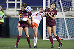 08 November 2013: Virginia's Alexis Shaffer (8) tries an overhead kick while being defended by Virginia Tech's Jodie Zelenky (6) and Taylor Antolino (17). The University of Virginia Cavaliers played the Virginia Tech Hokies at WakeMed Stadium in Cary, North Carolina in a 2013 NCAA Division I Women's Soccer match and the semifinals of the Atlantic Coast Conference tournament. Virginia Tech won the game 4-2.
