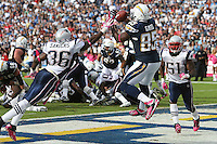 10/24/10 San Diego, CA:  New England Patriots safety Josh Barrett #36 and San Diego Chargers tight end Antonio Gates #85 during an NFL game played at Qualcomm Stadium between the San Diego Chargers and the New England Patriots. The Patriots defeated the Chargers 23-20.