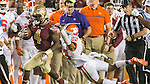 Florida State running back Dalvin Cook sheds Clemson safety Van Smith on his way to a 70 yard touchdown run in the second half of an NCAA college football game in Tallahassee, Fla., Saturday, Oct. 29,2016. Clemson defeated Florida State 37-34. (AP Photo/Mark Wallheiser)