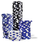 black white and blue stacks of poker chips