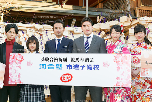(L to R) A member of the boy band EBiSSH, actress Risaki Matsukaze, politician Taizo Sugimura, Olympic judo gold medalist Mashu Baker and members of Tokyo Girls' Style pose for cameras during a special Kit Kat event to encourage Japanese students for the next school entrance exams, at Yushima Tenjin Shrine on January 12, 2017, Tokyo, Japan. Nestle's Kit Kat product is popular with students because its pronunciation in Japanese sounds like ''Kitto Katsu'' which means ''surely win''. Every year Japanese students tie hand-written wishes and messages at the shrine, wishing for luck in passing entrance exams to high school and colleges. The Yushima Tenjin Shrine is dedicated to the god of learning. (Photo by Rodrigo Reyes Marin/AFLO)