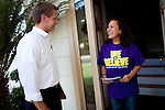 Democratic congressional challenger Eric Swalwell chats with Rose Cestra while campaigning door-to-door in Pleasanton, Calif., September 21, 2012.
