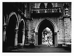 Female university student passes under neo-gothic gateway at Bombay University, Mumbai, India.