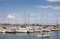 Yachts and sailing boats in Channel port of St Vaast La Hougue in Normandy, France