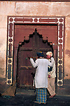 Asia, India, Uttar Pradesh, Fatehpur Sikri. Two men at one of the gates of Fatehpur Sikri.