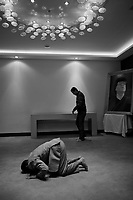 Tripoli, Libya, March 14, 2011.Members of a self-declared citizen committee composed of tribal leaders pray before a press conference they held for  foreign media journalists in one of tripoli's five stars' palaces.