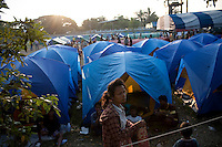 A refugee camp housing some of an estimated 20,000 Burmese refugees who had fled into Thailand to escape clashes in the border towns of Myawaddy and Pyaduangsu, only a day after a Burmese election which critics described as a sham..Ethnic minorities along the Thai-Burma border had warned earlier that the junta would launch a major offensive after the election, as many armed rebel groups had refused to become part of the government-controlled Border Guard Forces.&nbsp;
