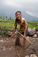 General views and village life: a young girl fishes for small fish and crabs in Gangate Village,  Sathakhani Bidishi, Surkhet district, Western Nepal, on 30th June 2012. In Surkhet, StC partners with Safer Society, a local NGO which advocates for child rights and against child marriage.  Photo by Suzanne Lee for Save The Children UK