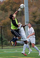 HYATTSVILLE, MD - OCTOBER 26, 2012:  Arion Sobers-Assue (13) of DeMatha Catholic High School backs into Luke Duffy (22) of St. Albans during a match at Heurich Field in Hyattsville, MD. on October 26. DeMatha won 2-0.