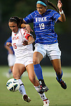 20 September 2012: Duke's Kim DeCesare (19) and Maryland's Erkia Nelson (15). The University of Maryland Terrapins played the Duke University Blue Devils to a 2-2 tie after overtime at Koskinen Stadium in Durham, North Carolina in a 2012 NCAA Division I Women's Soccer game.