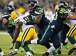 Seattle Seahawks guard James Carpenter (77) blocks Green Bay Packers defensive tackle Letroy Guion (98) in the NFL Kickoff Game game at CenturyLink Field in Seattle, Washington on September 4, 2014.  Seattle beat Green Bay 36-16. ©2014  Jim Bryant Photo. ALL RIGHTS RESERVED.