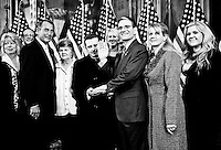 Speaker of the House John Boehner, left, poses with Rep. Joe Heck, R-Nev., and Heck's family during the ceremonial swearing-in photo op in the Capitol on Jan. 5, 2011. From left are sister in-law Laura, brother in-law John, Speaker of the House John Boehner, mother in-law Diana, Father Greg Gordon, daughter Monica, son Joe, Rep. Joe Heck, wife Lisa heck, and daughter Chelsea. (Photo By Bill Clark/Roll Call)