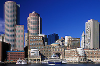 Boston Harbor Skyline, day. Rowes Wharf, Boston Harbor Hotel (center with arch). Customs house tower (right). Financial district high-rise buildings (rear) . Massachusetts