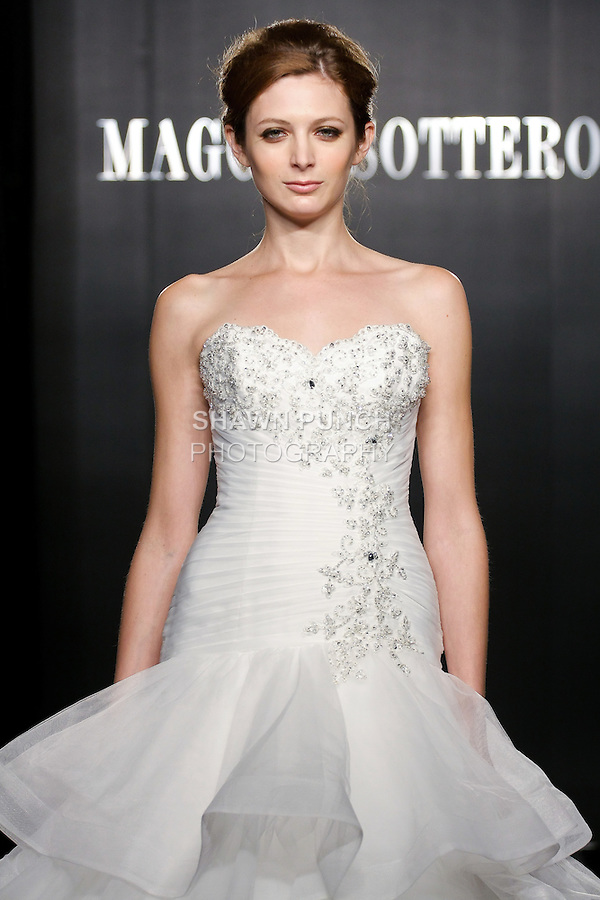 Model walks the runway in a Lorelei Haute Couture wedding dress from the Maggie Sottero Bridal Spring 2012 collection, during  Couture: New York Bridal Fashion Week 2012