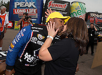 Mar. 17, 2013; Gainesville, FL, USA; NHRA top fuel dragster driver Antron Brown kisses wife Billie Brown as they celebrate after winning the Gatornationals at Auto-Plus Raceway at Gainesville. Mandatory Credit: Mark J. Rebilas-
