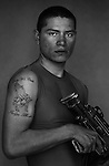PFC Jose Alcala, 19, Avenal, California, Weapons Platoon, Kilo Co., 3rd Battalion 1st Marines, 1st Marine Division, United States Marine Corps, at the company's firm base in Haditha, Iraq on Sunday Oct. 22, 2005.