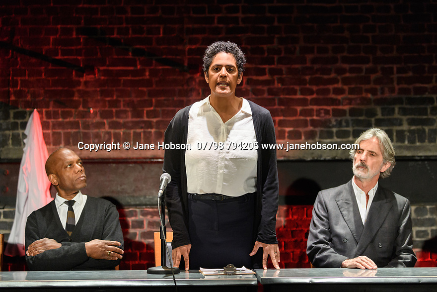 """London, UK. 10.04.2017. A brand new adaptation of Albert Camus' """"The Plague"""" opens at the Arcola Theatre. Adapted and directed by Neil Bartlett. Picture shows: Burt Caesar (Grand), Sara Powell (Dr Rieux), Martin Turner (Mr Tarrou). Photograph © Jane Hobson."""